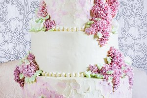 Wedding festive Cake With cream flowers lilac On White Background