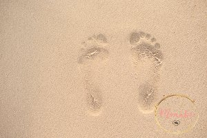 Woman Footprints in the sand