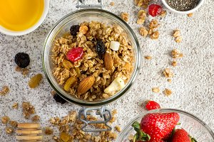 Granola with Strawberry, nuts and honey. Healthy breakfast set.