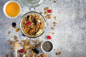 Granola with dry fruits, nuts and honey. Healthy breakfast set.