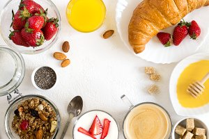 Healthy breakfast set: Granola, berries, croissant and coffee. F