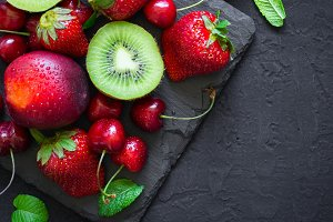 Mix of Juicy summer fruits and berries. Strawberry, cherry, kiwi