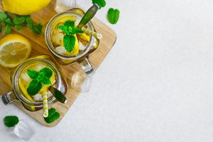 Green ice tea with lemon and mint in a glass jar. Top view with