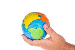 man hand holding globe