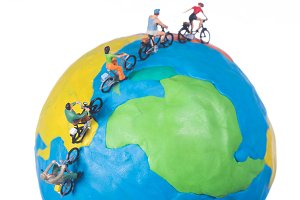 miniature people riding bicycle