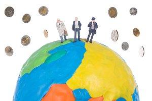 miniature people on the globe