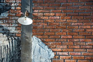 vintage light bulb on red brick wall