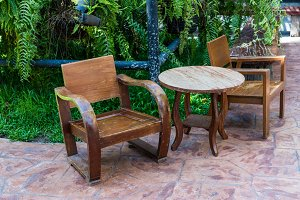wooden table set in garden
