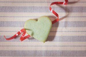 Green butter cookie, heart shaped