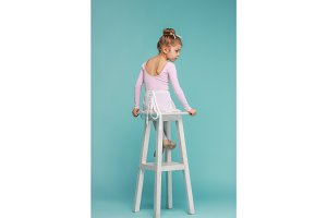 The little balerina dancer on blue background