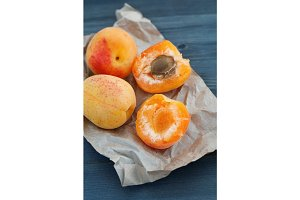 Close-up of fresh apricots on a kraft paper