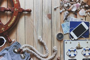 Phone, passports, money, wheel, compass and marine decorations