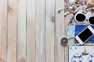 Phone, passports, money, compass and marine decorations