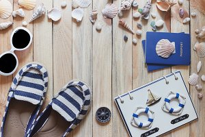 Striped espadrille, compass, passports and marine decorations