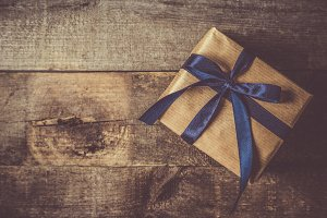 Father's day concept - present, tie on rustic wood background