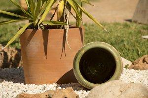 A jar lying down and a flowerpot