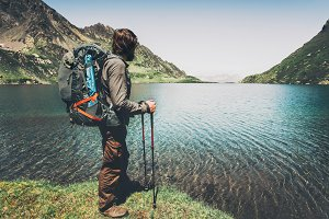 Man backpacker hiking at lake
