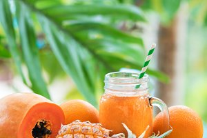 Tropical exotic pineapple papaya fruits juice