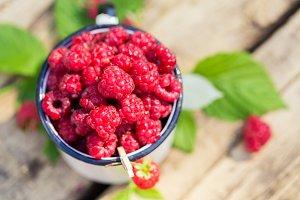 Heap of fresh sweet raspberries cup vitamin fruit