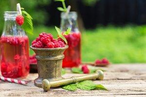 raspberries mortar pestle making detox juice drink