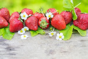 Perfect aroma sweet strawberry border on wood