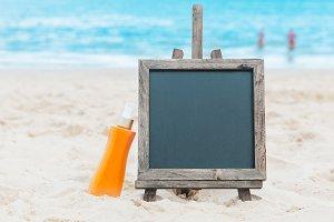 Chalk board sunscreen cream sand beach tropic