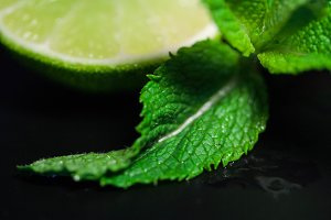 Mint leaves against lime