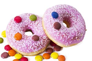 Donuts with candies isolated on white