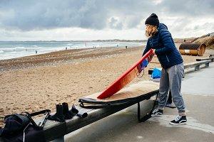 Woman preparing her surf board