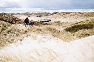 Friends hiking in dune landscape
