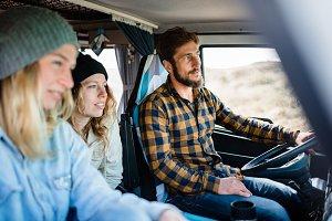 Three friends traveling in campervan