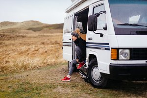 A woman and her old camper van