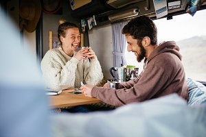 Two friends relaxing in camper van