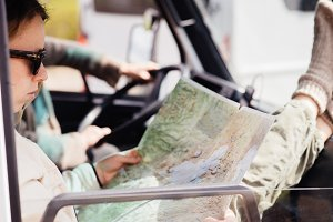 Woman reading map in camper van