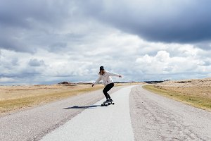 Young woman on long board