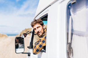 Portrait of young man driving a van