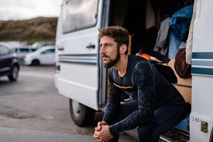 Surfer taking a break at camper van