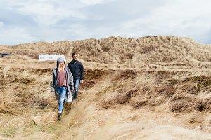 Couple hiking through dune landscape