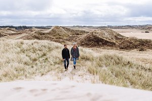 Couple hiking through the dunes