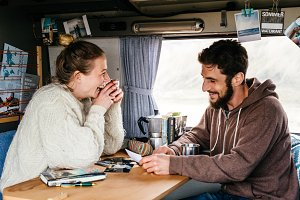 Couple relaxing in a camper van