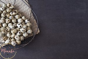 Wire mesh basket with quail eggs