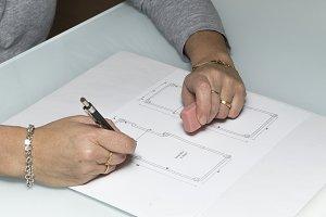 Architect woman drawing