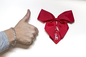 Thumb up and red ribbon