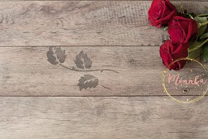 Floral frame on wooden background