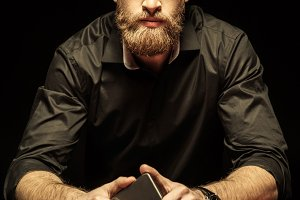 bearded man sitting at poker table