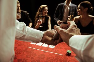 dealer shuffling cards in hands
