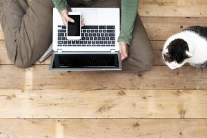 Woman on laptop with her cat