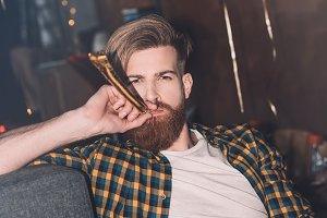 bearded man with party blower