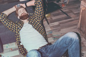 drunk bearded man lying on floor