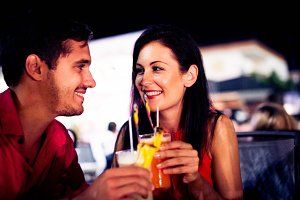 Young Couple Enjoying Cocktails On A Night Out